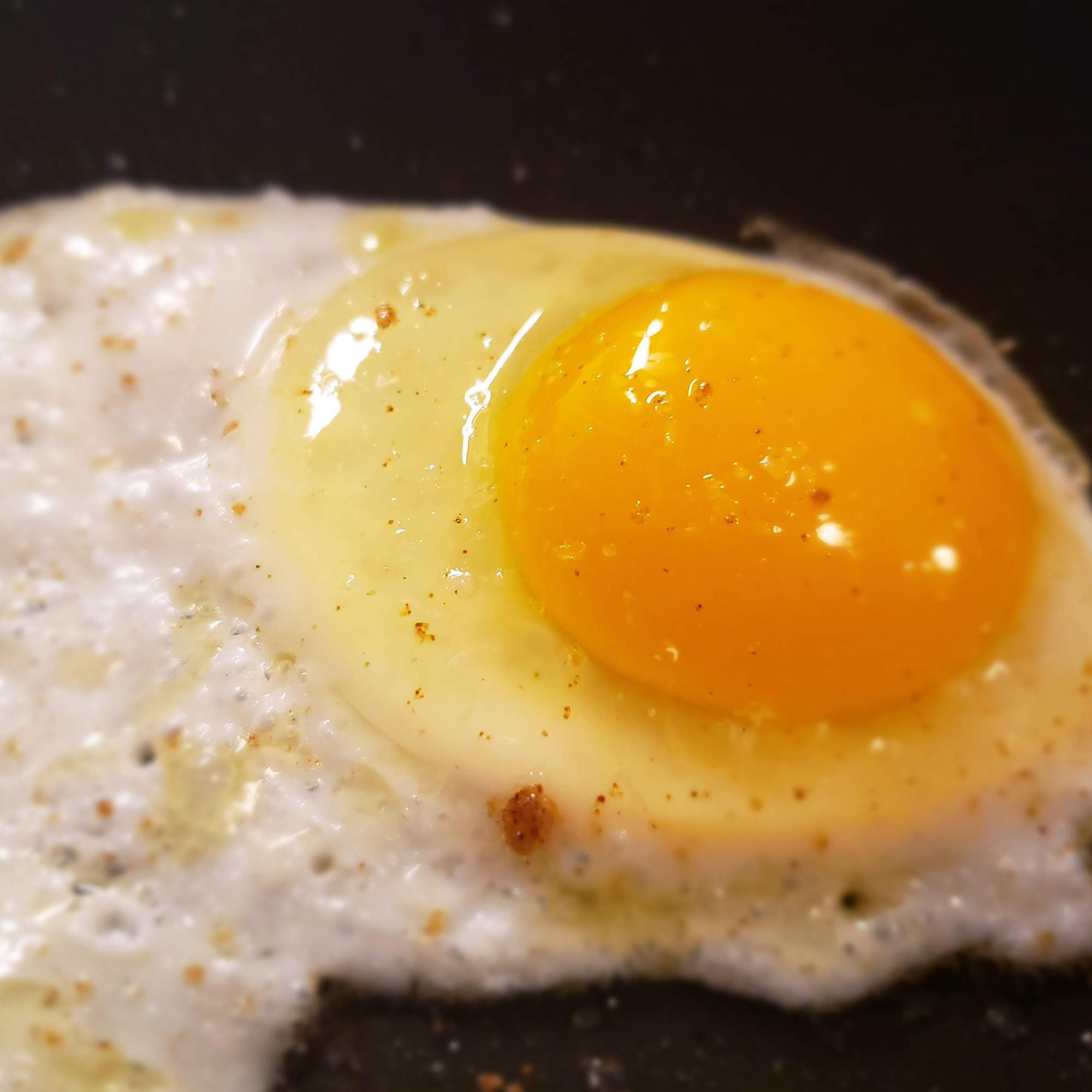 Egg frying in a skillet