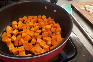 Sweet potato cubes sauteing in skillet